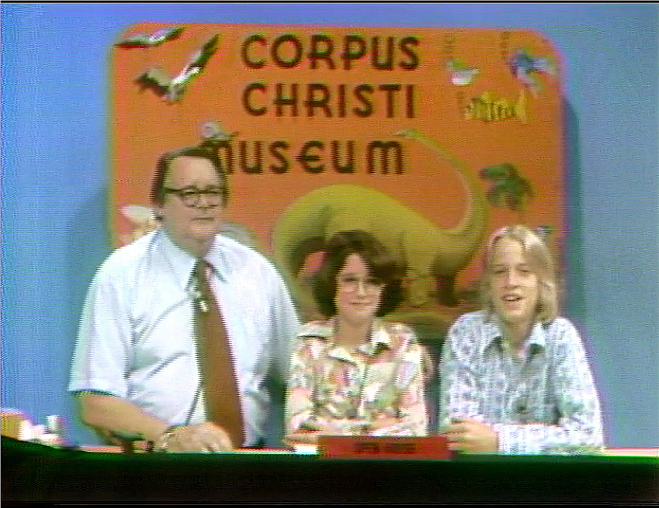 Corpus Christi Museum director Aalbert Heine (left) hosted a weekly show discussing the museum exhibits from the late 1950s to 1984. The show's guests were local kids, like Courtney Barker (center) and Steve Canine (right) in this screengrab from a vintage episode.