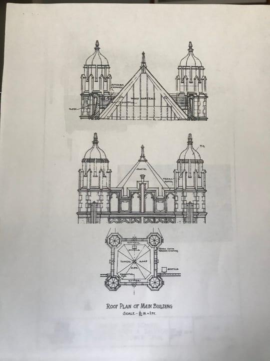 A copy of the original Camden High School shows the spires.