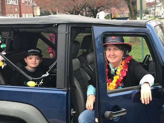 Margie Long, a co-founder of Maple Shade Spreads the Birthday Love!, prepares to parade with her son Shane.