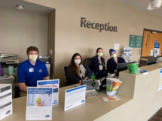 Adena Health System employees working at reception.