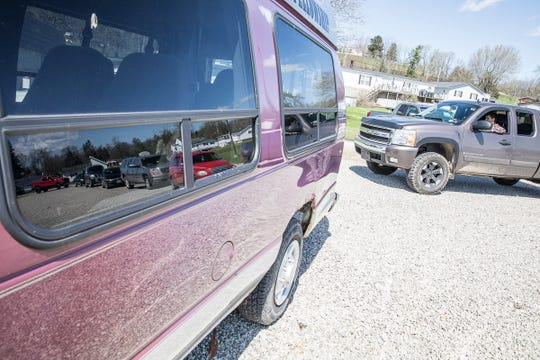 Cars start to line up around the parking lot as they wait to participate in a drive thru communion at Real Joy Community Fellowship Church on March 29, 2020 in Chillicothe, Ohio.