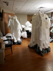 Suits ready for the St. Elizabeth Infectious Response Team in the Fort Thomas hospital, where COVID-19 patients are being treated.