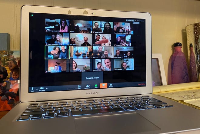 The Faust family gathers with a group of young adult Jewish couples from the Cincinnati area via video conference with Rabbi Shena Potter Jaffee, of the Mayerson JCC, for a virtual Shabbat dinner on Friday, March 20 during the Ohio's stay-at-home order. (Photo provided, Rachel Mara)
