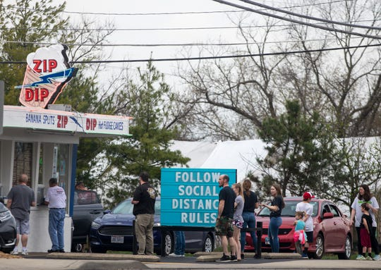 People wait in line at Zip Dip on Saturday, March 28, 2020 in Green Township.