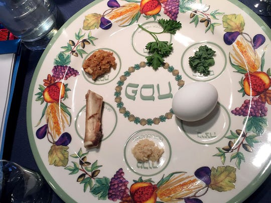 A Seder plate features the ceremonial foods around which the Seder is based: matzah, the zeroa (shankbone), egg, bitter herbs, charoset paste and karpas vegetable.(Provided photo, The Moore Family)