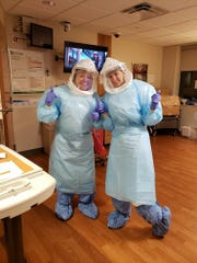 Two members of the St. Elizabeth Infectious Disease Response Team in the Fort Thomas hospital.