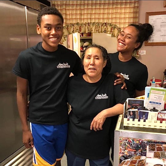 Yon Sun Smith, center, owner of the Korean restaurant Dae Bak ChopHouse, smiles with daughter Tammy Lee Brown, who is the manager, and grandson Bryson Burns on March 31, 2020.