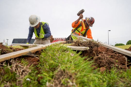 Crews work Monday to construct sidewalkson Wilma Rudolph Boulevard from south of Center Pointe Road to Holiday Drive near the Interstate 24 Exit 4 junction.