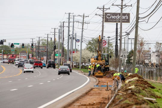 TDOT and construction crews work on building sideway paths between Center Poointe Drive and Holiday Drive along Wilma Rudolph Blvd in Clarksville, Tenn., on Monday, March 30, 2020.