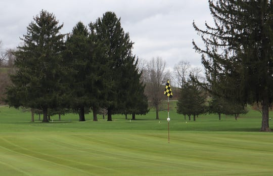 One of the greens at Hickory Flats was mowed on Tuesday. The golf course is allowed to be open during the coronavirus pandemic as long as it follows the state health mandates.
