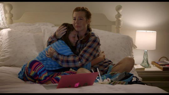 """Tanna Frederick as Kathy and Rylie Behr as Cori in the film """"Two Ways Home."""""""