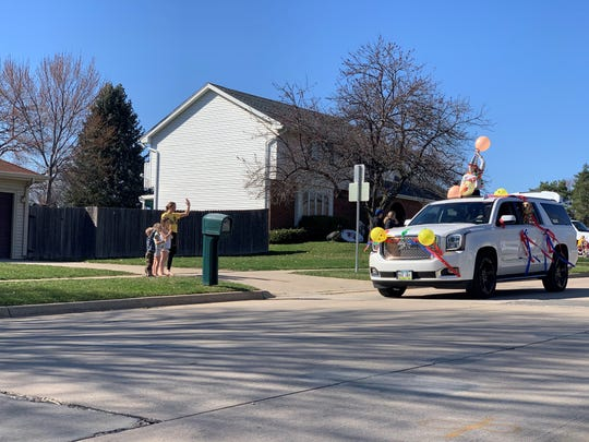 Western Hills Elementary teachers celebrate their students and families during a drive-by parade Monday, March 30, 2020.