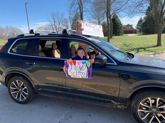 Jordan Creek Elementary students share their messages with their teachers from the safety of their cars Monday, March 30, 2020.