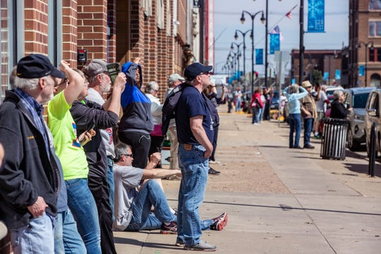 Hundreds watch as workers lift the new dome atop Marshall County courthouse in Marshalltown Tuesday, March 31, 2020.