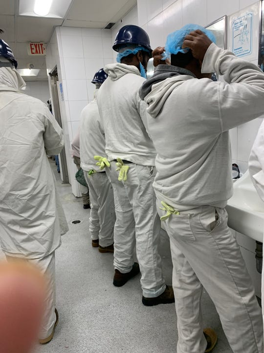 Workers are getting ready at the JBS plant in Marshalltown last week. Workers have complained that some parts of the plant are crowded, making it unsafe for workers trying to avoid the spread of coronavirus. The photos were supplied to the Iowa League of United Latin American Citizens.