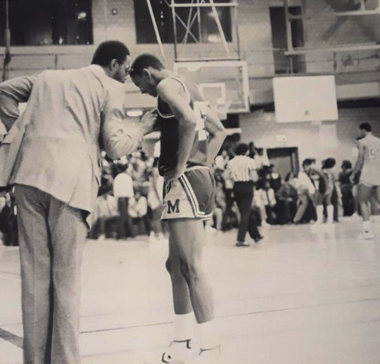 Dwight Jones speaks with player Eric Longmire in this photo from their matchup against Mackenzie in 1981.