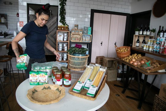 Rohani Foulkes, owner of Folk Detroit organizes her store in Corktown on March 31, 2020. Folk Detroit is doing pre-order only groceries to help keep her business afloat during the stay at home order due to the Novel Coronavirus threat.