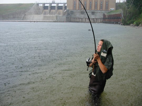Fishing for salmon at the Tippy Dam on the Manistee River is popular for anglers.