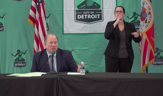 Mayor Mike Duggan speaks Tuesday, March 31, 2020, about the city's coronavirus response at a press conference at Eastern Market in Detroit.