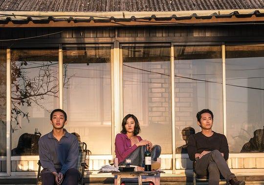 "Ah-In Yoo, Jong-seo Jun and Steven Yeun in ""Burning."""