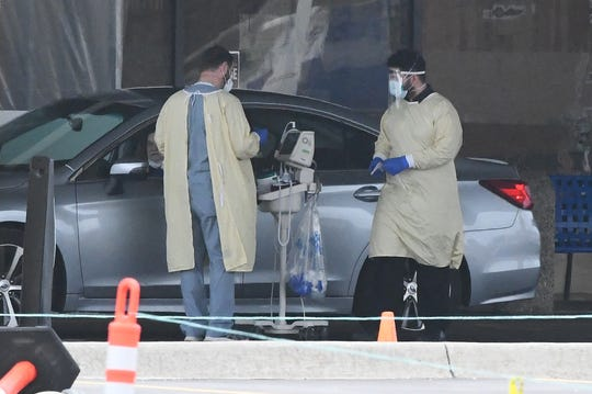 Coronavirus virus testing at the North entrance of Beaumont hospital in Royal Oak, Michigan on March 31, 2020.