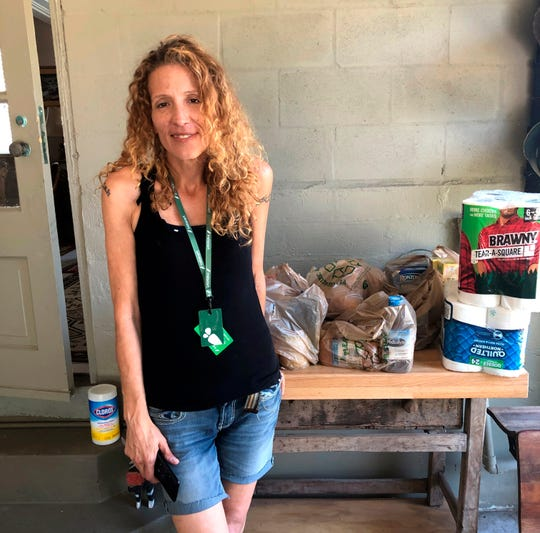 Instacart gig worker Summer Cooper, 39, delivers groceries, March 28, 2020, in Belleair Beach, Fla. Cooper started working as an Instacart shopper in the Tampa Bay area in Florida recently after losing her position as a server at a hotel restaurant.