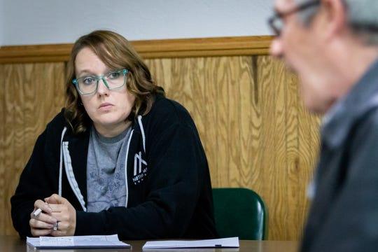 Councilmember Sara Walker listens to Council President Michael Farber.