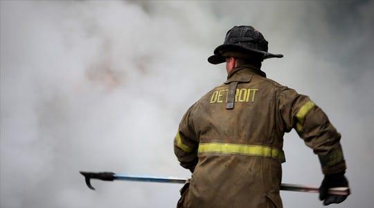 "A Detroit firefighter in ""Burn."""