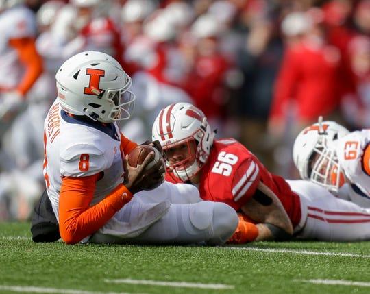 Wisconsin linebacker Zack Baun (56) sacks Illinois quarterback M.J. Rivers (8)