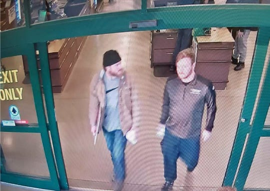 In this file image from a Jan. 1, 2020, surveillance video released by the U.S. Attorney's office in Maryland, Brian Mark Lemley Jr, right, and Patrik Mathews leave a store in Delaware where they purchased ammunition and paper shooting targets.