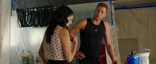 "Cecily Strong and Blake Griffin in ""The Female Brain."""