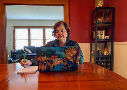 Lisa Kaenzig, dean of William Smith College, works from her home while following coronavirus Stay-at-Home guidelines in Geneva, N.Y. on March 27.