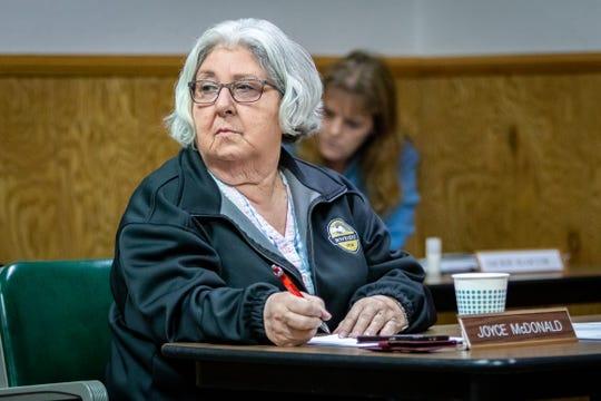 Councilmember Joyce McDonald listens during the council meeting.
