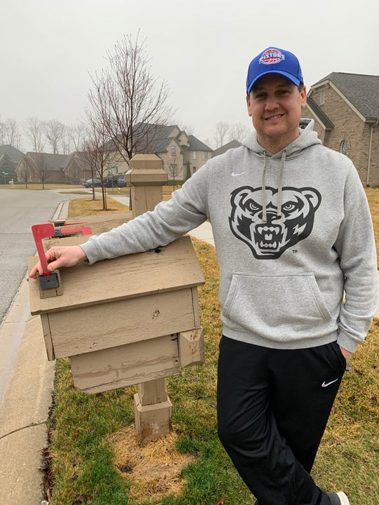 Neal Ruhl stands next to his co-star, his mailbox.