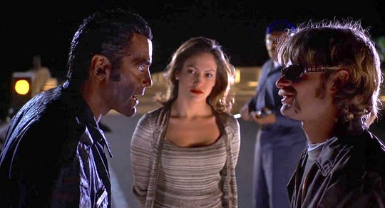 "George Clooney, Jennifer Lopez, Ving Rhames and Steve Zahn in ""Out of Sight."""