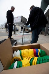 Boxes of 3D printed masks are donated at Meridian Mall in Okemos, Tuesday, March 31, 2020.