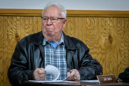 Hesperia Village Councilmember Jim Smith listens during a council meeting. The Hesperia Town Council met for the first time in 10 months on March 26, 2020, in Hesperia, Michigan.