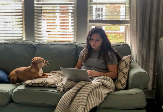 Vicktery Zimmerman works from her home in Chicago during the coronavirus-related order to shelter in place on March 27. A self-proclaimed extrovert, Zimmerman has come up with workarounds like video calls to help herself deal with the lack of social interaction.