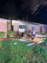 Two homes were damaged in a semi crash Monday night.