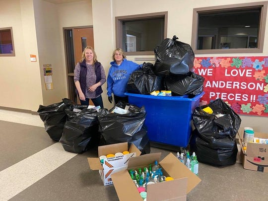 St. Mary's Springs Academy teachers Carol Dahlinger, left, and Lisa Holz, right stand with the schools more than seven bags of donations for Advocate Aurora Health. The school donated Kleenex, paper towel, anti-bacterial wipes and hand sanitizer.