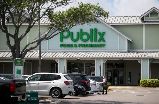 Customers shop at the Publix in the Colonial Crossings Shopping Plaza on Tuesday, March 31, 2020. Publix owns the plaza and is helping tenants who rent the other spaces for their businesses.