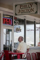 Larry Hines waits for a takeout order from Philly Junction in the Colonial Crossings Shopping Plaza on Tuesday, March 31, 2020, in Fort Myers.