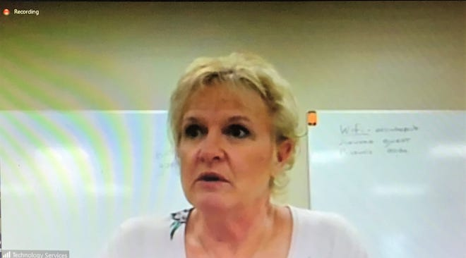 Debbie Konitzer, Oconto County's Public Health Officer, is seen on a monitor speaking to County Board members and officials Tuesday about the coronavirus public health emergency. The meeting was held over Zoom, and most board members attended remotely.
