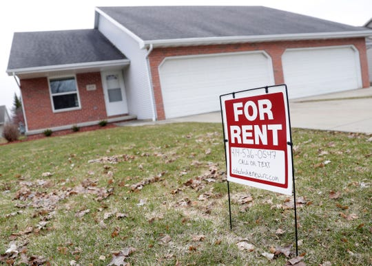 A for rent sign is pictured outside a duplex on March 31, 2020, in De Pere, Wis. Sarah Kloepping/USA TODAY NETWORK-Wisconsin