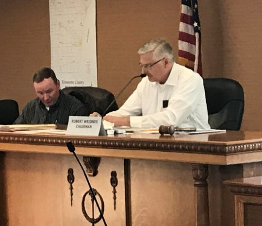 Robert Weidner, right, presides over the March 17 meeting of the Kewaunee County Board as its chairman. Weidner is not seeking re-election after 20 years on the board and 14 of the past 16 as chairman.