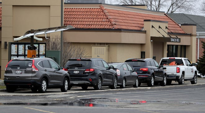Cars lined up at the West Mason Street Taco Bell drive-through on Tuesday in Green Bay.