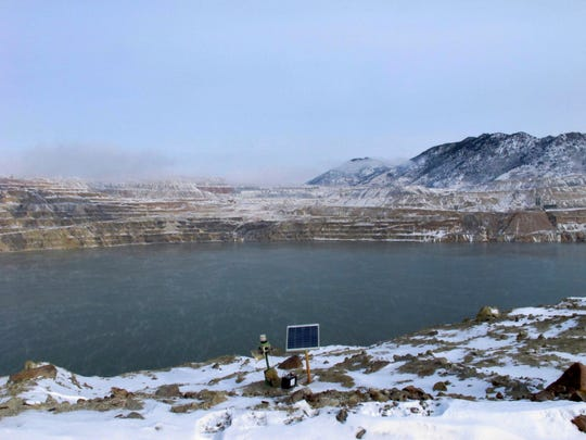 FILE - In this Dec. 14, 2016, file photo, a Phoenix Wailer bird deterrent sits on the bank of the Berkeley Pit in Butte, Mont. The wailer, which emits different sounds at random times, is one of the devices used to keep birds from landing in the toxic water of the former copper mine. The Trump administration is moving to scale back criminal enforcement of a century-old law protecting most American wild bird species. (AP Photo/Matt Volz, File)