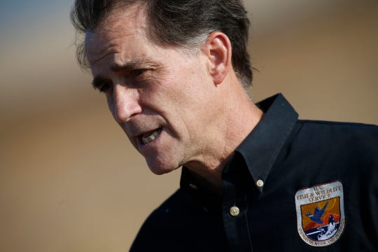 """FILE - In this Oct. 5, 2015, file photo, Dan Ashe, then-director of the U.S. Fish and Wildlife Service, talks following an animal release at the Rocky Mountain Arsenal National Wildlife Refuge in Commerce City, Colo. Former U.S. Fish and Wildlife Service Director Ashe told The Associated Press that the Migratory Bird Treaty Act's threat of prosecution served as """"a brake on industry"""" that had saved probably billions of birds. (AP Photo/David Zalubowski, File)"""