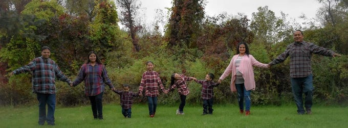 The Stanfield LaForge family poses for a photo. Amid the coronavirus pandemic, some Indigenous families have welcomed more people into their homes.