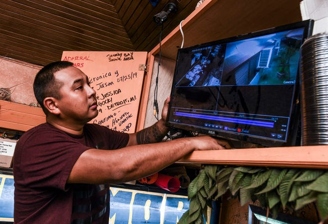 George Taylor Jr. reviews video, recorded early Monday morning, of an individual caught on surveillance cameras rummaging through the Chamorro Island Bar-B-Q restaurant, on Tuesday, March 31, 2020. The restaurant and six other businesses at the Chamorro Village were burglarized, some time between March 13 and March 30, said Sgt. Paul Tapao, Guam Police Department spokesman. During the same period, operations at the venue was inactive due to the governor's executive order of closures implemented to reduce the spread of the coronavirus.